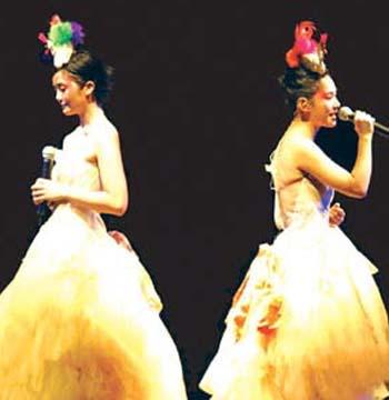 反倒觉得很可爱,twins就像两个快乐的小天使,在舞台上又唱又跳,把现场