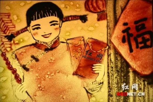 在琼湘籍艺术家创作年味彩色沙画诉乡情