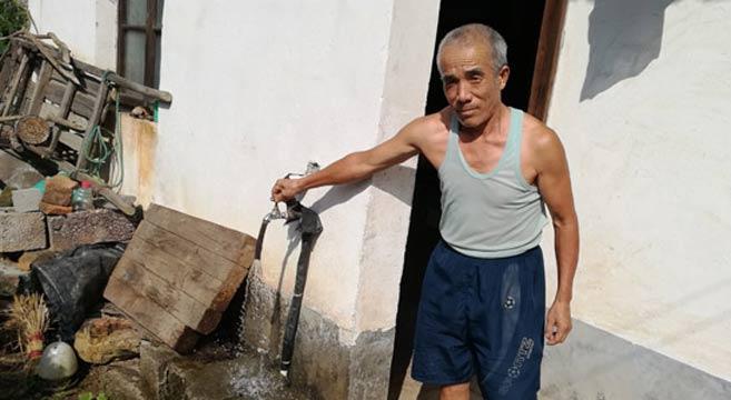 """洞口县:村民喝上""""健康水"""" 贫困户收到""""水红包"""""""