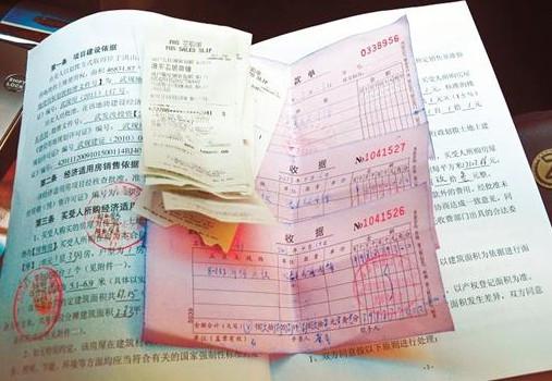 手写收据模板下载-114万元买下一间商铺 购房者3个月拿不到发票图片