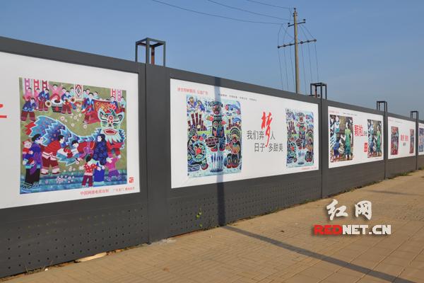 建筑工地围挡换公益广告外衣 长沙文明创建添新名片图片