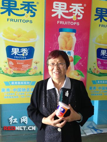 湖南果秀食品有限公司董事长阳国秀。