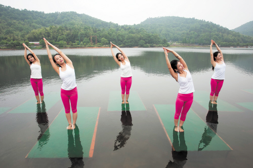 Yoga enthusiasts dance in water