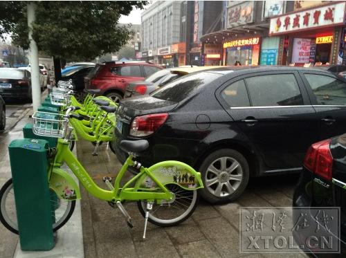 """与机动车停车位靠太近 湘潭公共自行车有""""家""""不能回"""