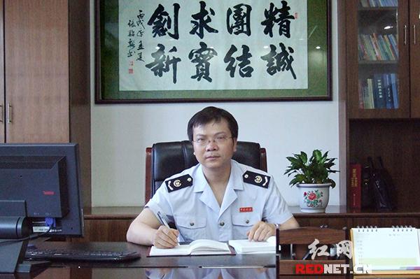 邵阳市国税局稽查局局长覃小满。