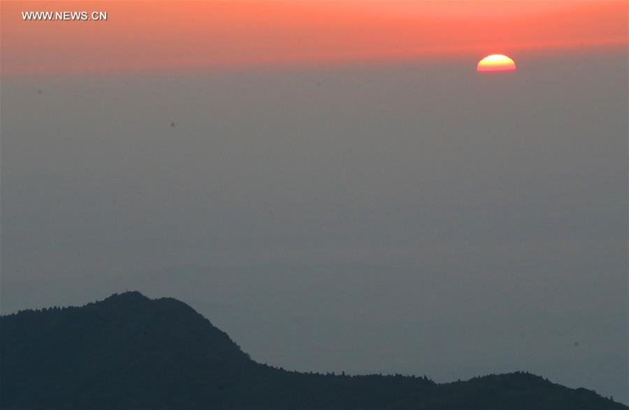 Tourists view sunrise at Hengshan Mountain scenic area in C China