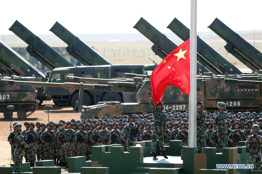 Xi inspects troops as China's military might on show
