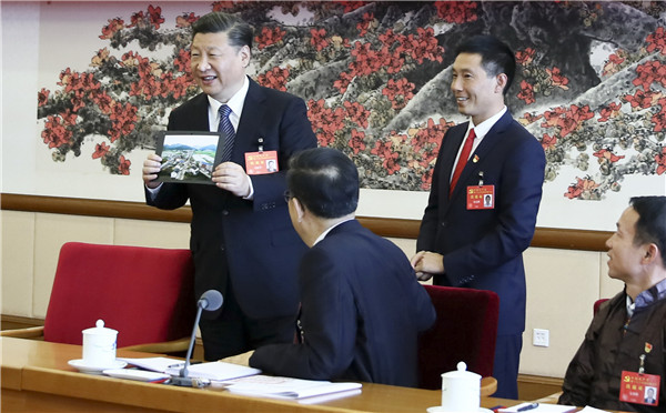 Xi urges all to strive for progress