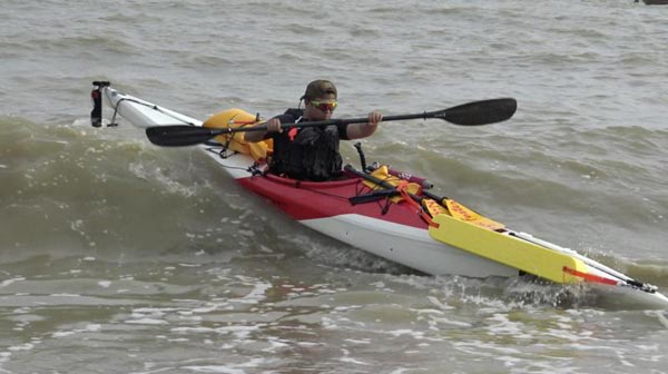 Man kayaks along China's coastline
