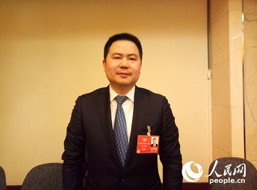 全国政协委员、四川恒和信律师事务所主任李正国。人民网记者 单薇摄